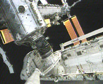 The International Space Station's new S3/S4 truss and solar arrays are viewed from Space Shuttle Atlantis' robotic arm