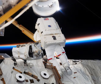 im Reilly participates in the first spacewalk of STS-117 on Monday