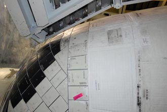 The section of Endeavour's OMS pod is compared to that seen on Atlantis.