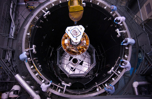 Phoenix being lowered into thermal vacuum chamber