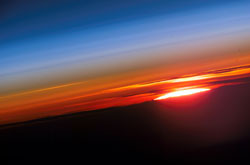 ISS015-E-10469 --- The profile of the atmosphere and a setting sun