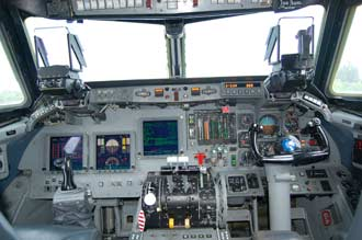 The cockpit of the Shuttle Training Aircraft features a shuttle control stick and a regular control area.