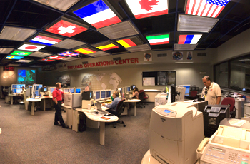 Flags of space station partner nations can be seen on the ceiling of the payload control room