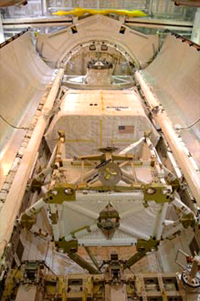 A hexagonal module can be seen in the shuttle's cargo bay
