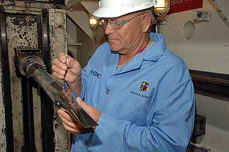 AEDC tunnel operator Ronnie Robison adds the finishing touches to the HyBoLT model