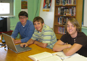 Jared Hagan, Tyler Pennington and Morgan Harless sit at a desk