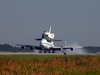 Space Shuttle Atlantis with support convoy.