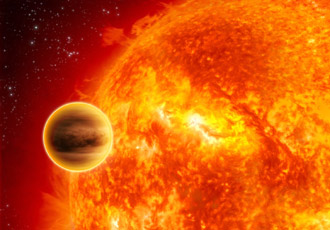 artist's concept shows a gas-giant exoplanet transiting across the face of its star