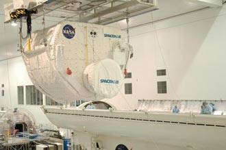 A SPACEHAB module is loaded into a payload cannister for the trip to the launch pad.