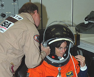 Mission Specialist Barbara Morgan gets her flight suit fitted