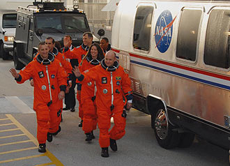The Endeavour crew members walk toward the Astrovan