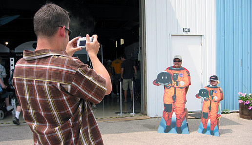 Visitors to the NASA pavilion at AirVenture 2007 take their picture as an astronaut