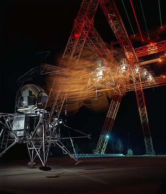 A multiple-exposure image of a simulated lunar landing at the NASA gantry in April 1967