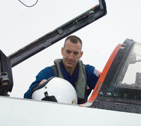 Astronaut Charlie Hobaugh enters a NASA T-38 trainer jet