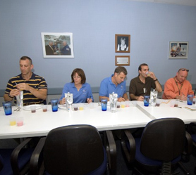 Some members of the STS-118 crew taste orange-pineapple drink