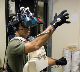 Astronaut Rick Mastracchio wears virtual reality goggles and gloves during training