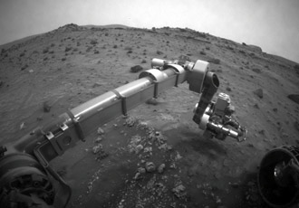 Spirit moving its robotic arm