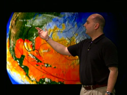 Screenshot of Dr. Halverson standing in front of an animation of Sea Surface Temperatures