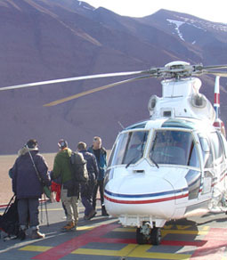 Image of members of the expedition boarding a helicopter.