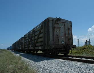 Railcars line the dunes.