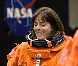 Astronaut Barbara Morgan wearing an orange shuttle launch and entry suit