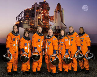 Formal portrait of mission STS-118 crew members.