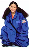 Young Bianca wears a blue flight suit that is far too big for her