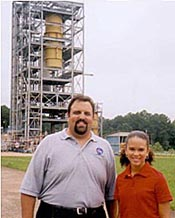 Steve Cook and Bianca standing in front of a large test stand