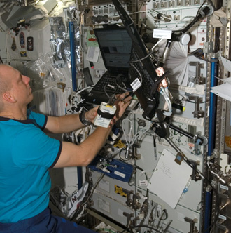 Expedition 15 Flight Engineer Clay Anderson works with the CCISS experiment.