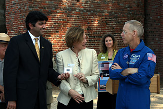 Astronaut Pat Forrester (right) presents the Jamestown cargo tag to Va. Secretary of Technology Aneesh Chopra (far left) and AVPA Executive Director Elizabeth Kostelny (front, center)