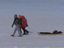Scientists trek kilometers away from their campsite to take sensitive measurements.