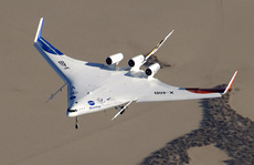 X-48B Blended Wing Body aircraft flies over the edge of Rogers Dry Lake at Edwards Air Force Base, Calif.