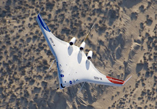 X-48B Blended Wing Body aircraft flies over the edge of Rogers Dry Lake at Edwards Air Force Base, Calif.,