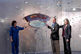 Mission Specialist Barbara R. Morgan (left) helps dedicate a plaque outside the Mission: Space attraction.