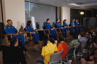 The astronauts answer questions from the student audience.