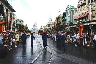The STS-118 crew members march down Main Street at Walt Disney World in Orlando.