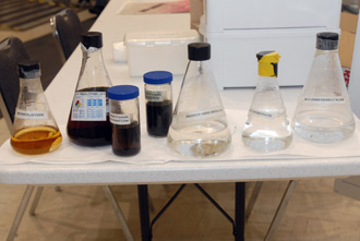 Beakers containing fluids from various stages of water processing