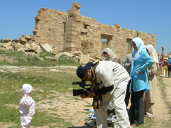 NASA TV on location taping Libyan citizens near the Libyan Coast. In the background, are some of the remnants of the ancient Roman City of Leptis Magna.