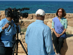 On location filming one of the numerous interviews for the documentary. Madhulika Guhathakurta, NASA program scientist in Washington, was one of the featured scientists in the film. In the background, is the breathtaking Mediterranean Sea.