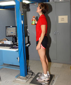 Volunteer Dauna Coulter weighs in before exercising and again after working out to see how much moisture she produced for the water processor.