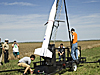 Johnathan McClure stands on a platform beside the rocket as the team prepares for launch