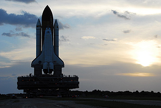 Discovery makes it way to the pad at sunrise.
