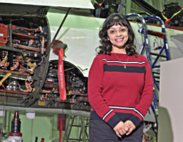 NASA Dryden instrumentation engineer Gina Branco in front of NF-15B aircraft.