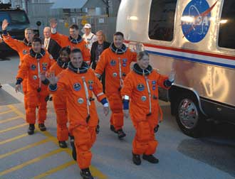The crew of STS-120 walks out to the astrovan.