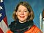 Pam Melroy in a training version of her orange launch and entry spacesuit