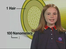 A girl stands in front of an enlarged cross-section drawing of a hair