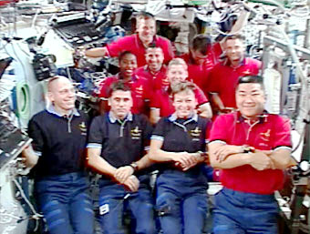 Shuttle and station crews participate in the joint crew news conference