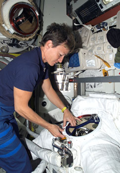 ISS015-E-36035 : Astronaut Peggy Whitson with  spacesuit