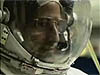 Screen capture from video of astronaut wearing EVA helmet