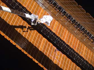 Astronaut Scott Parazynski on a spacewalk repairing a solar wing Source: